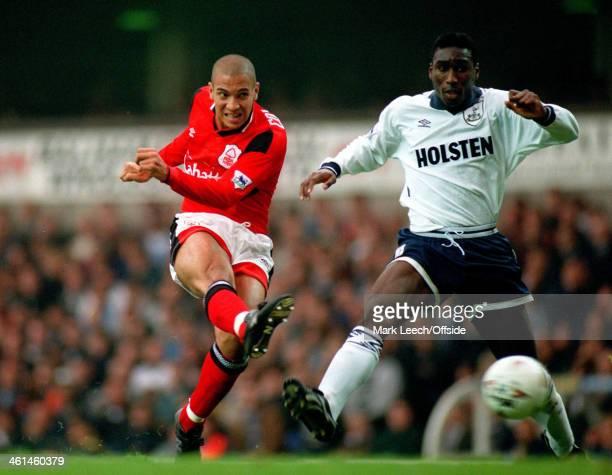24 September 1994 FA Premiership Tottenham Hotspur v Nottingham Forest Stan Collymore shoots past Sol Campbell of Tottenham