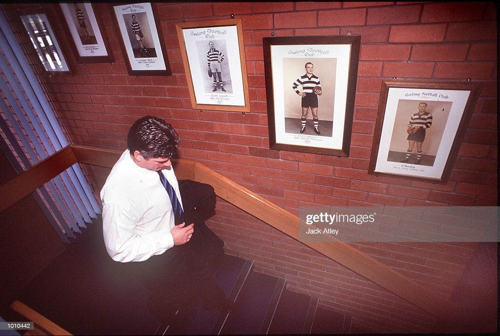 Australian Football League club Geelong coach Gary Ayres walks past club portraits of former players following his press conference where he announced he is leaving the club to take up a position with the Adelaide Crows. Mandatory Credit: Jack Atley/ALLSPORT