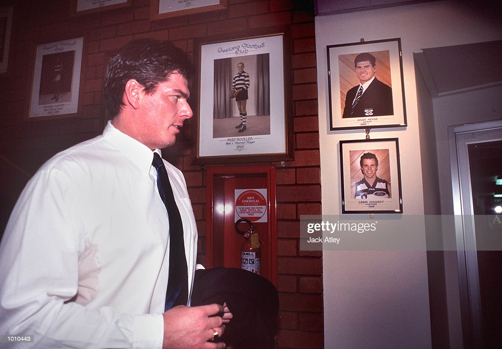 Australian Football League club Geelong coach Gary Ayres walks past the club portraits of himself and 1999 captain, Leigh Colbert following his press conference where he announced he is leaving the club to take up a position with the Adelaide Crows. Colbert walked out on the club yesterday. Mandatory Credit: Jack Atley/ALLSPORT