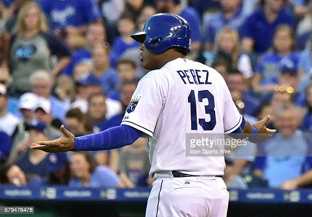 Kansas City Royals' catcher Salvador Perez appeals to the umpire after being hit by a pitch in the second inning during a Major League Baseball game...