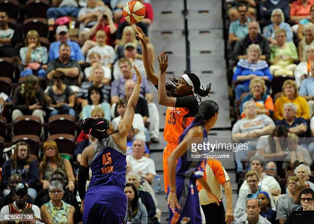 Connecticut Sun Center / Forward Jonquel Jones shoots the ball over Phoenix Mercury Center Kelsey Bone during the game as the Connecticut Sun host...