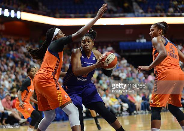 Phoenix Mercury Center Kelsey Bone drives to the basket as Connecticut Sun Center / Forward Jonquel Jones defends during the game as the Connecticut...