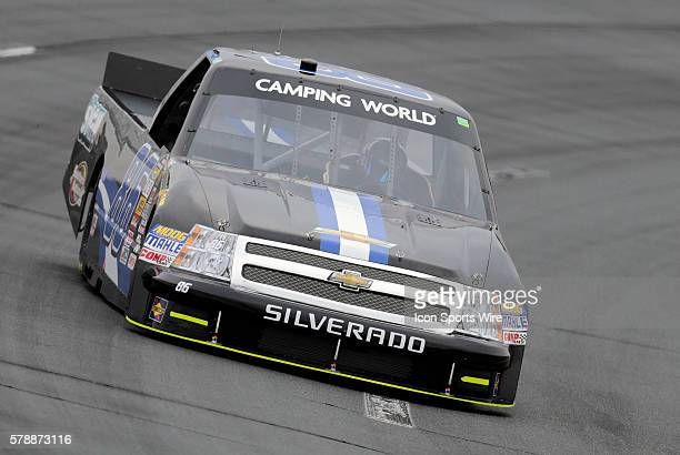 Brandon Brown NASCAR Camping World Truck Series driver of the Dominion Recycling Chevy truck during qualifying for the UNOH 175 at New Hampshire...