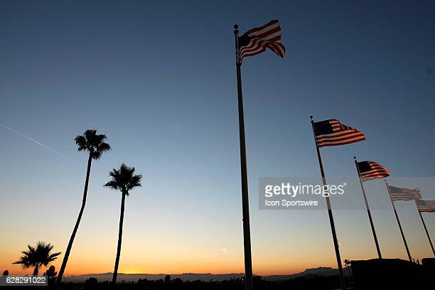 Flags and palm trees line the sky of dodger stadium during a major league baseball game between the Los Angeles Dodgers and the San Diego Padres at...