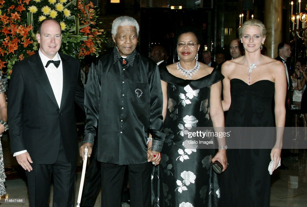 2 September 2007, Hotel de Paris. Monaco, A charity gala evening organised by Prince Albert II and <a gi-track='captionPersonalityLinkClicked' href=/galleries/search?phrase=Nelson+Mandela&family=editorial&specificpeople=118613 ng-click='$event.stopPropagation()'>Nelson Mandela</a> to benefit Amade Mondiale, <a gi-track='captionPersonalityLinkClicked' href=/galleries/search?phrase=Nelson+Mandela&family=editorial&specificpeople=118613 ng-click='$event.stopPropagation()'>Nelson Mandela</a> Foundation, <a gi-track='captionPersonalityLinkClicked' href=/galleries/search?phrase=Nelson+Mandela&family=editorial&specificpeople=118613 ng-click='$event.stopPropagation()'>Nelson Mandela</a> Children's Fund and the Mandela Rhodes Foundation. Pictured, <a gi-track='captionPersonalityLinkClicked' href=/galleries/search?phrase=Prince+Albert+II+of+Monaco&family=editorial&specificpeople=201707 ng-click='$event.stopPropagation()'>Prince Albert II of Monaco</a>, <a gi-track='captionPersonalityLinkClicked' href=/galleries/search?phrase=Nelson+Mandela&family=editorial&specificpeople=118613 ng-click='$event.stopPropagation()'>Nelson Mandela</a>, his wife Graca Machel and South African olympic swimmer <a gi-track='captionPersonalityLinkClicked' href=/galleries/search?phrase=Charlene+-+Princess+of+Monaco&family=editorial&specificpeople=726115 ng-click='$event.stopPropagation()'>Charlene</a> Wittstock pose for photographer.