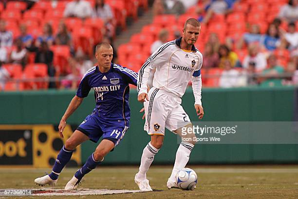 David Beckham of the Galaxy moves the ball past Jack Jewsbury of the Wizards The MLS Kansas City Wizards shut out the visiting LA Galaxy 20 at...