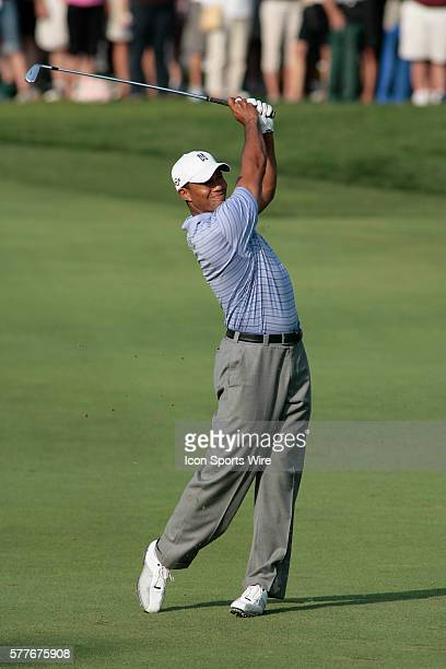 PGA Pro Tiger Woods hits his approach shot to the 18th hole during the 3rd round of the BMW Golf Classic at Cog Hill Golf Club in Lemont Illinois...