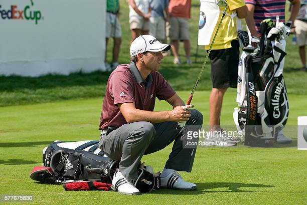 Spain's PGA Pro Sergio Garcia takes rest while waiting to tee off during 2nd Round action at the BMW Golf Classic at Cog Hill Golf Club in Lemont...