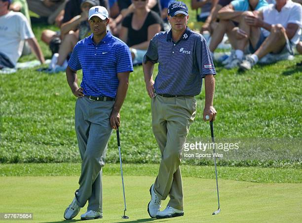Tiger Woods and Steve Stricker wait for Heath Slocum to putt in round one of the BMW Championship at Cog Hill Golf and Country Club in Lemont IL
