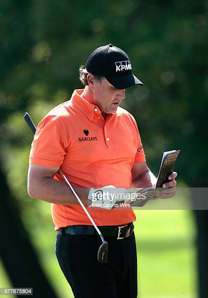 PGA Pro Phil Mickelson checks his notes as he leaves the 11th hole during 2nd Round action at the BMW Golf Classic at Cog Hill Golf Club in Lemont...