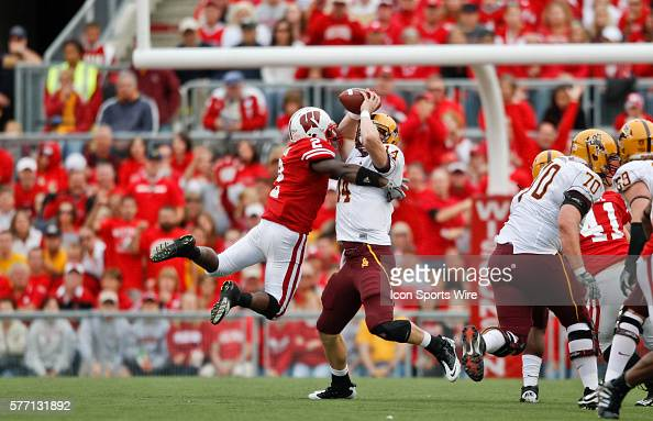 Arizona State Sun Devils quarterback Steven Threet is tackled by Badgers defensive back Jay Valai in game action The Wisconsin Badgers defeated the...