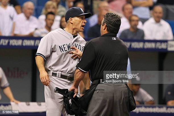 New York Yankees manager Joe Girardi is held back by home plate umpire Rob Drake as he screams at Tampa Bay Rays relief pitcher Steven Geltz who hit...