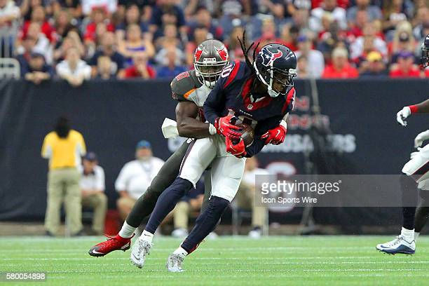 Bruce Carter of the Buccaneers wraps up DeAndre Hopkins of the Texans during the regular season game between the Tampa Bay Buccaneers and the Houston...