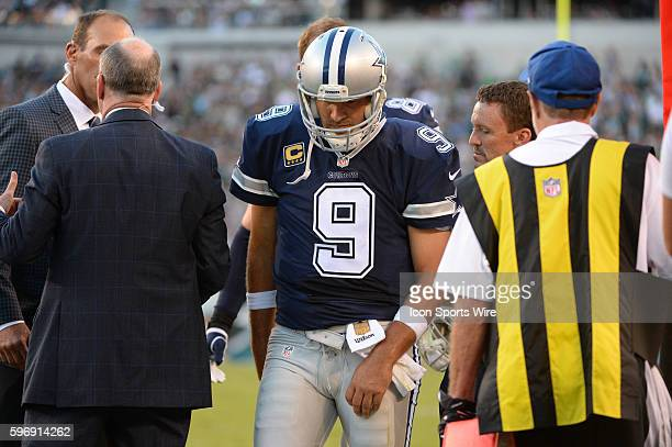 Dallas Cowboys quarterback Tony Romo walks off the field with trainer after getting sacked by Philadelphia Eagles outside linebacker Jordan Hicks and...