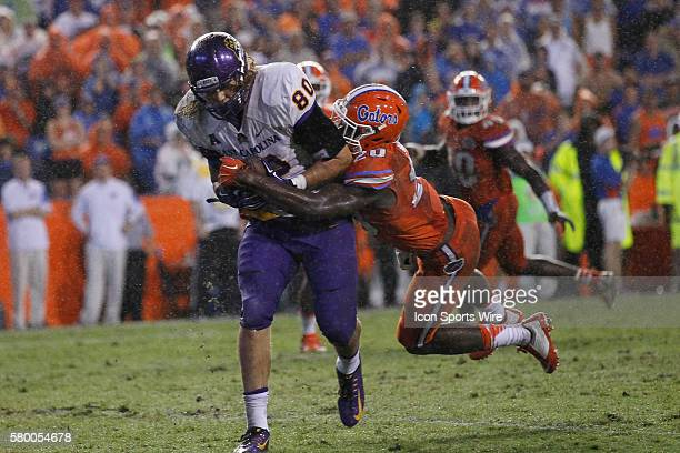 East Carolina Pirates tight end Bryce Williams catches a pass for a touchdown well being covered by Florida Gators defensive back Marcus Maye in the...