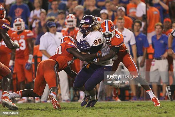 East Carolina Pirates tight end Bryce Williams is tackled by Florida Gators defensive back Marcus Maye and Florida Gators defensive back Nick...