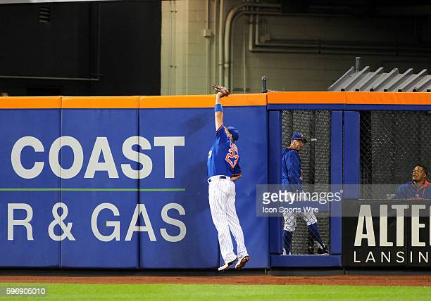 New York Mets Outfielder Michael Cuddyer [2799] leaps high in air to catch a fly ball during the game between the New York Yankees and the New York...