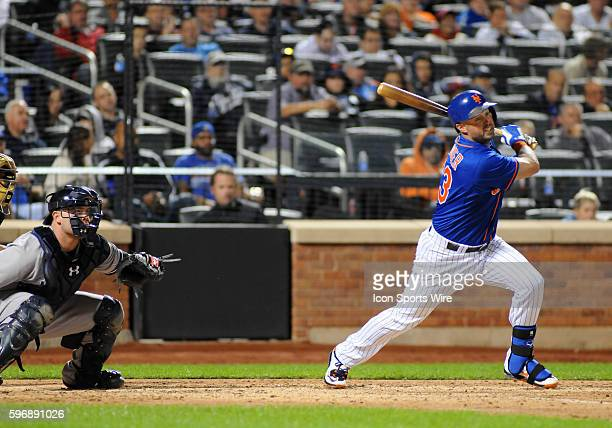 New York Mets Outfielder Michael Cuddyer [2799] lines a base hit during the game between the New York Yankees and the New York Mets The game was...
