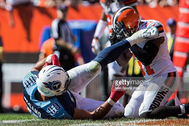 Tennessee Titans Tight End Anthony Fasano [7798] crosses the plane of the goal despite the tackle of Cleveland Browns Safety Donte Whitner [8878] for...