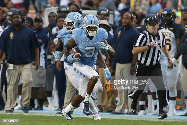 UNC's Sam Smiley races up the field with a fumble recovery The University of North Carolina Tar Heels hosted the North Carolina AT State University...