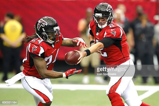 Atlanta Falcons quarterback Matt Ryan hands off to running back Devonta Freeman in the Tampa Bay Buccaneers 3124 victory over the Atlanta Falcons at...