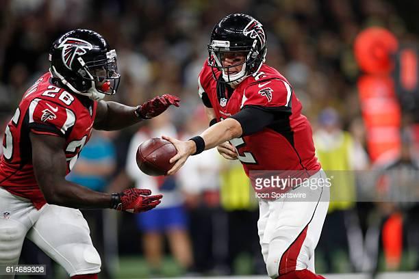 Atlanta Falcons Quarterback Matt Ryan hands the ball off to Atlanta Falcons Running Back Tevin Coleman during a game against the New Orleans Saints...