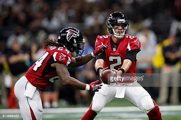 Atlanta Falcons Quarterback Matt Ryan hands the ball off to Atlanta Falcons Running Back Devonta Freeman during a game against the New Orleans Saints...