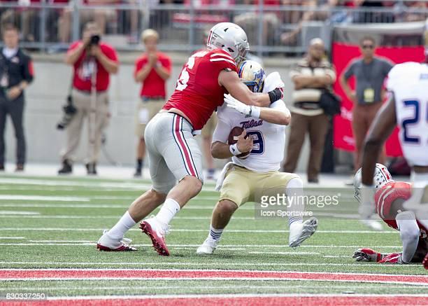 Defensive end Sam Hubbard of the Ohio State Buckeye sacks quarterback Dane Evans of the Tulsa Golden Hurricane during the game between the Ohio State...