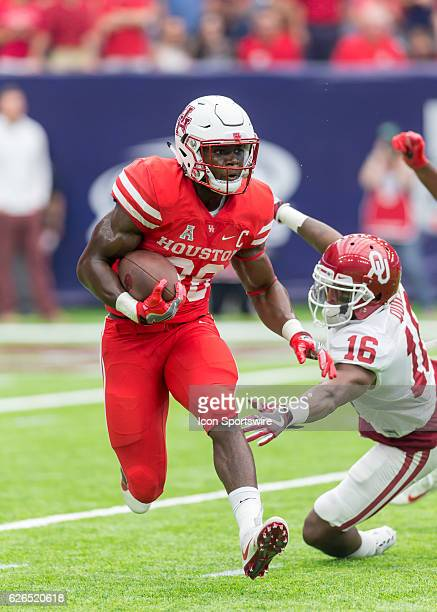 Houston Cougars cornerback Brandon Wilson and Oklahoma Sooners defensive back Michiah Quick during the AdvoCare Texas Kickoff football game between...