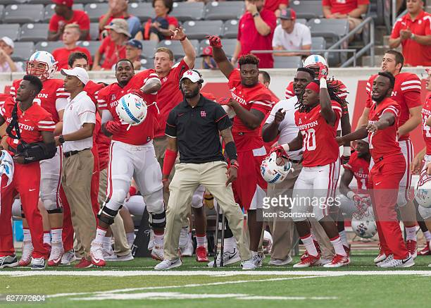 Houston Cougars sideline cheers during the NCAA football game between the Lamar Cardinals and Houston Cougars at TDECU Stadium in Houston Texas