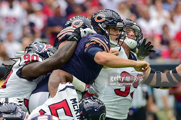Houston Texans Linebacker Jadeveon Clowney Houston Texans Defensive End JJ Watt and Houston Texans Linebacker Benardrick McKinney sandwich Chicago...
