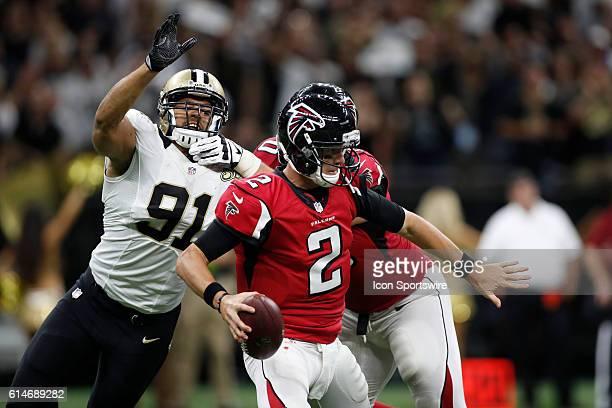 New Orleans Saints Defensive End Kasim Edebali reaches for Atlanta Falcons Quarterback Matt Ryan at the MercedesBenz Superdome in New Orleans LA