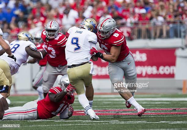 Ohio State Buckeyes defensive end Sam Hubbard applies the pressure and sacks Tulsa Golden Hurricane quarterback Dane Evans during the game between...