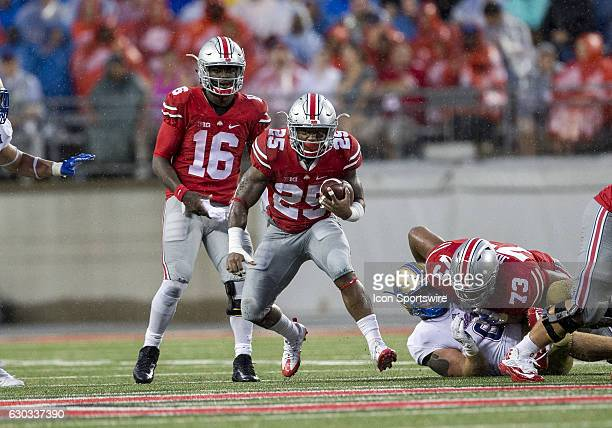 Ohio State Buckeyes running back Mike Weber looks for extra running room during the game between the Tulsa Golden Hurricanes and the Ohio State...