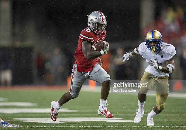 Ohio State Buckeyes wide receiver Dontre Wilson looks for the end zone during the game between the Tulsa Golden Hurricanes and the Ohio State...