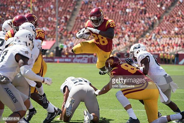 Southern California tailback Aca'Cedric Ware dives for the end zone during an NCAA football game between the Utah State Aggies and the USC Trojans at...