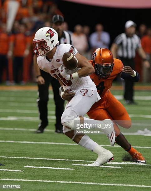 Syracuse Orange linebacker Zaire Franklin knocks the ball from Louisville Cardinals tight end Cole Hikutini during a NCAA football game between the...