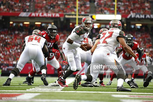 Tampa Bay Buccaneers quarterback Jameis Winston hands off to running back Doug Martin in the Tampa Bay Buccaneers 3124 victory over the Atlanta...