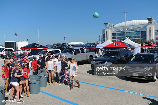 Texans fans playing beer pong with a volleyball and garbage cans while tailgating before the NFL game between the Chicago Bears and Houston Texans at...