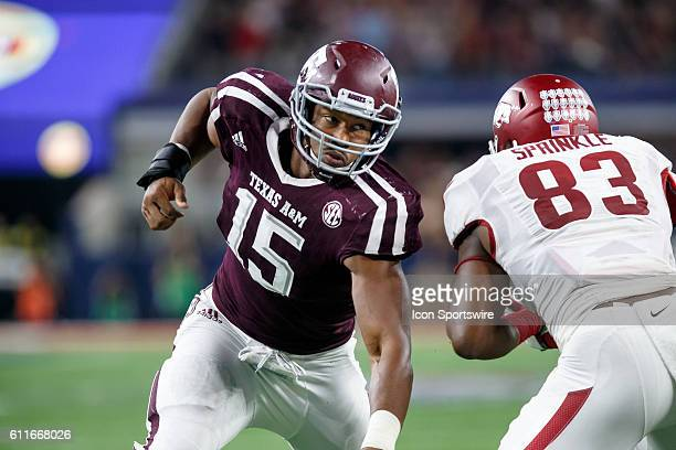 Texas AM Aggies defensive end Myles Garrett works around Arkansas Razorbacks tight end Jermey Sprinkle during the Southwest Classic college football...