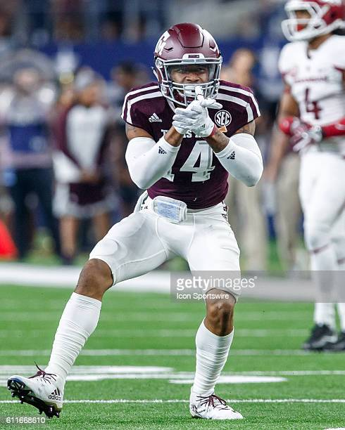 Texas AM Aggies safety Justin Evans claps after making a tackle during the Southwest Classic college football game between the Arkansas and Texas AM...