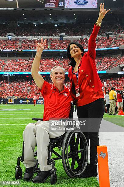 Texas Governor Greg Abbott and University of Houston Chancellor Renu Khator before the AdvoCare Texas Kickoff between the Oklahoma Sooners and...