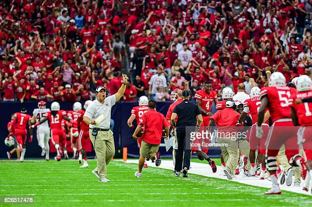 The Cougar sideline erupts as Houston Cougars cornerback Brandon Wilson returns an attempted Sooner field goal for a touchdown during the AdvoCare...