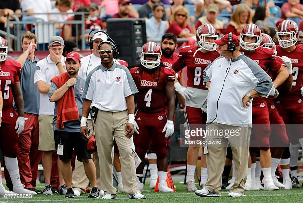 Umass assistant coach/recruiting coordinator/inside linebackers coach Charles Walker and Umass assistant coach/defensive line and special teams Matt...