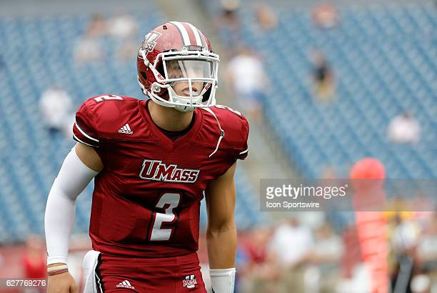 UMass quarterback Ross Comis checks the call from the sidelines The Boston College Eagles defeated the University of Massachusetts Minutemen 267 at...