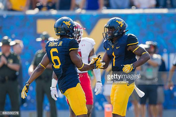 West Virginia Mountaineers WR Daikiel Shorts Jr and West Virginia Mountaineers WR Ka'Raun White celebrate after White scored on a 57yard touchdown...
