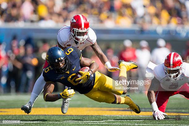 West Virginia Mountaineers WR Daikiel Shorts Jr is tackled by Youngstown State Penguins CB Eric Thompson after making a catch during the second...