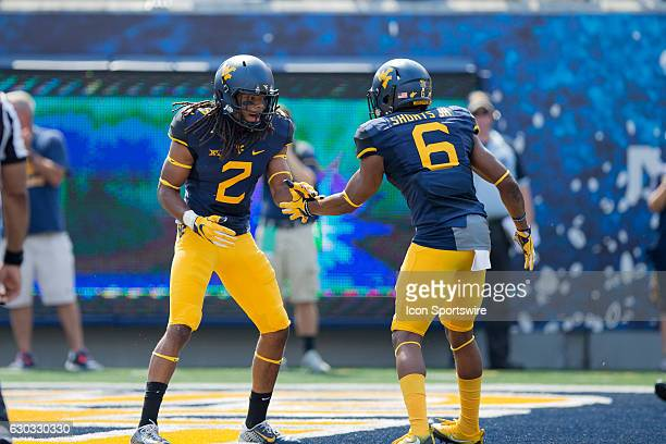 West Virginia Mountaineers WR Ka'Raun White and West Virginia Mountaineers WR Daikiel Shorts Jr celebrate after White scored on a 53yard touchdown...