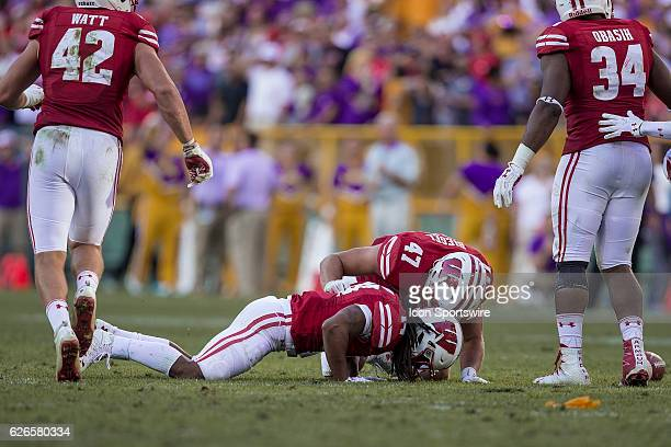 Wisconsin Badgers outside linebacker Vince Biegel takes with Wisconsin Badgers safety D'Cota Dixon after getting hit by a late hit as the Wisconsin...