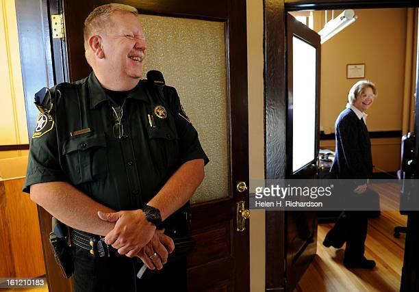 WALDEN CO September 22 2011 During a recess in court Judge Cindy Wilson right jokes with Deputy Sheriff James 'Tex' Brandon who is also a local EMT...